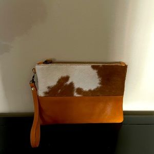 Leather and pony hair wristlet